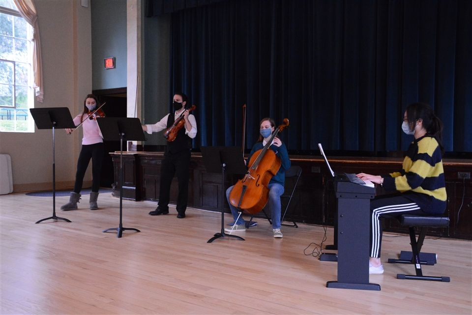 Quartet group performs in the Auditorium before Thanksgiving Break.