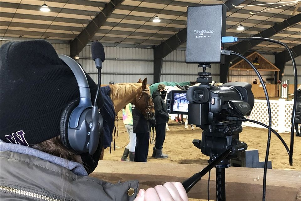 An AV student operates a camcorder during a livestream recording IEA show February 6th.