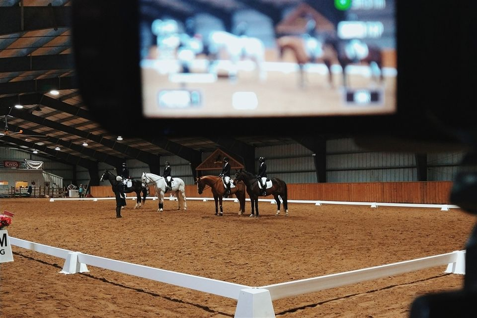 Edith M. captures a dual image of the riding show being recorded and live streamed to Grier's YouTube channel.