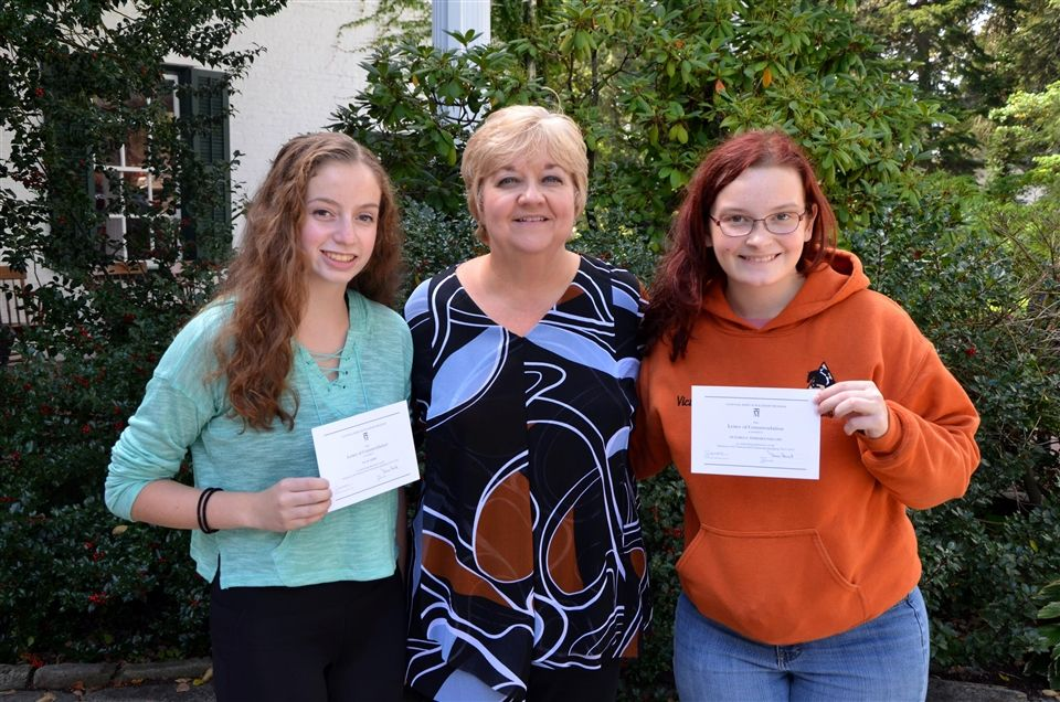 Head of School Gina Borst with award winners Tia and Victoria.
