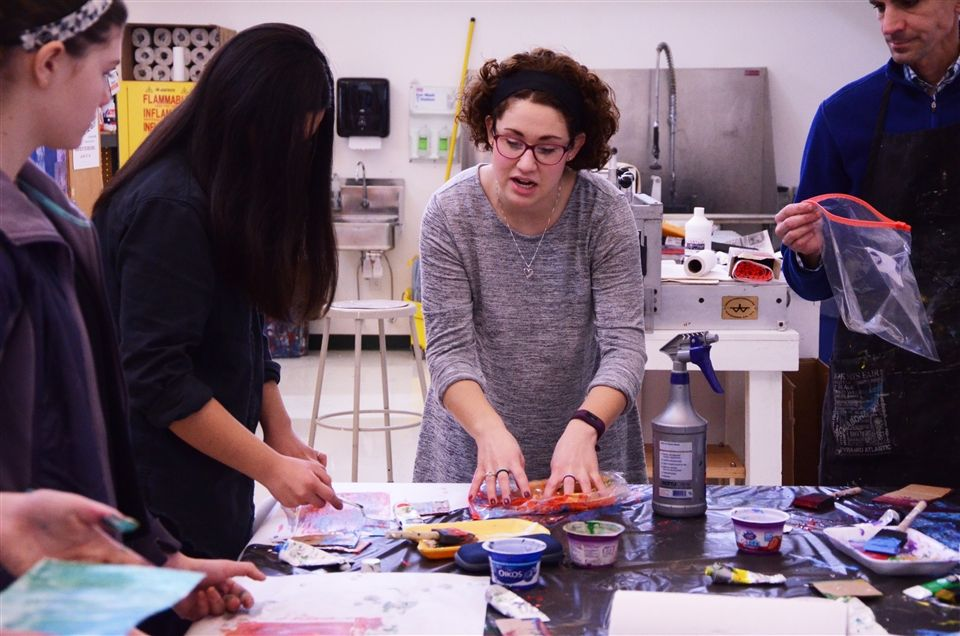 Visiting artist Felicia Frank explains a process to Grier art students.