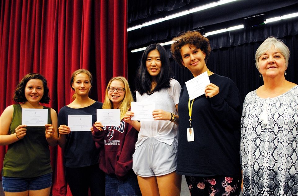 Mrs. Gina Borst stands proudly with seniors Mary D., Jaden H., Nora V., Lilian Z., and Emily C. who received National Merit® Letters of Commendation.