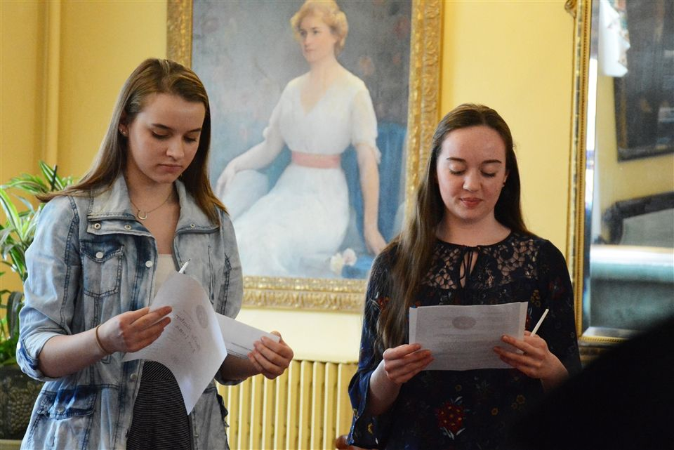 Shelby H. and Lauren S. among students being inducted into the Language Honor Society.