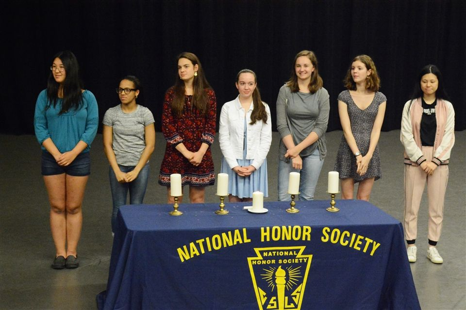 Several current NHS members speak at the ceremony.