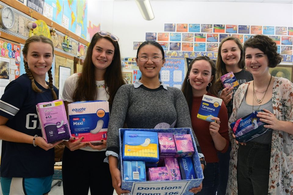 Shelby, Kristen, Michelle, Lauren, Bella, and Rachel hold the donations collected for Girls Helping Girls. Period.