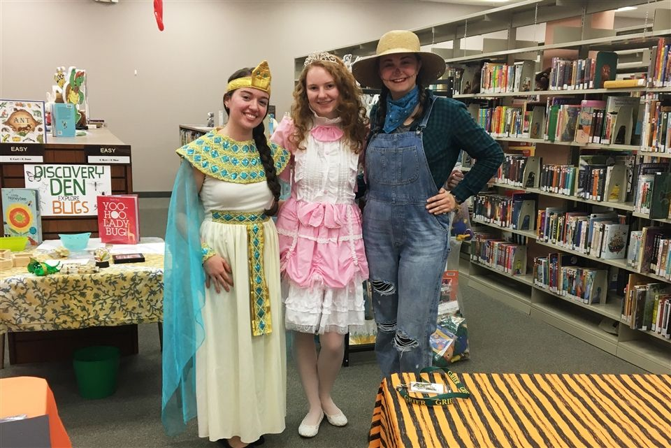 NHS students brought some spooky fun to the Tyrone-Snyder Public Library when they assisted with the Library's Children's Halloween Party. Grier students Lauren, Bella, and Maggie wore costumes and helped children from the Tyrone community make crafts, play games, and have a fun Halloween experience. The princesses, vampires, witches, superheroes, and newsies in attendance had a great time!