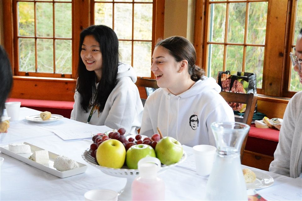 French students at Grier reenacted the Parisian tradition of Le Diner en Blanc  by wearing white and enjoying a tabletop picnic of a variety of cheeses, French bread, and fruit.