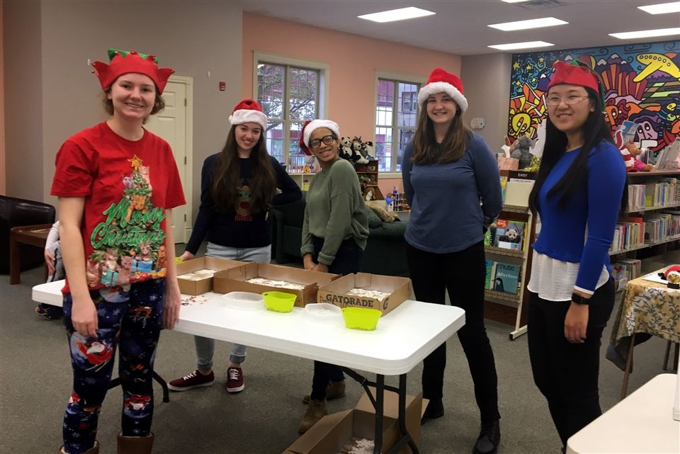 Grier NHS volunteers brought their holiday spirit to the Tyrone-Snyder Public Library for a Holiday Open House. Children from the community enjoyed building with Legos, crafting a holiday snowflake ornament, and participating in a library scavenger hunt. Alexa T, Lauren S, Maggie A, Michelle S, Sherry X, Amy T, and Bella W wore festive sweaters and Santa hats while they engaged with the children in this fun and festive event.