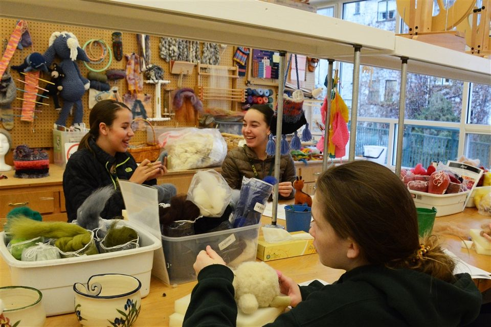 Students in fiber arts class are creating sculptural needlepoint felt animal projects.