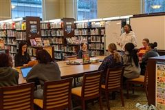 Simone leads the first Bubble Talk, held after school on Monday, February 10th. The topic of the town hall-style meeting was to increase understanding between students of diverse ethnicity.