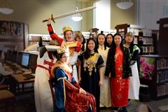 Art History class stops by the library to display their Medieval costumes.