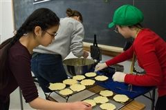 Nodoka and Katie cooling pizzelles for the Italy group.