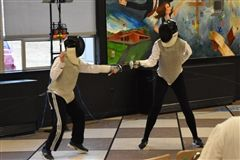 Grier spars with fencers from Bishop Guilfoyle High School in Altoona, PA.