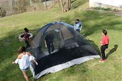 Mr. Lang's 3rd period English 9 class erects a tent in Mrs. Borst's backyard.
