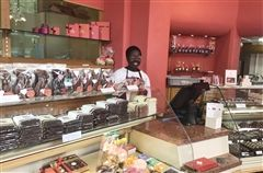 Zai behind the counter of the During Chocolatier in Switzerland, where she apprenticed during the summer and strengthened her command of the French Language.
