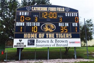 Brown & Brown scoreboard at Holy Trinity's Catherine A. Ford football field