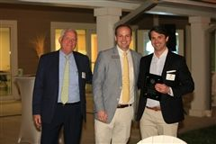 Tommy Webb and Michael Sumner '04 present Beau McIntosh '97 with the Alumni Service Award