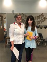 Annika '25 pictured with Mrs. Stephanie Sutter-Shoaf, 6th Grade English teacher