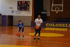 QJ Peterson helps with shooting drills at MMA's summer basketball camp.