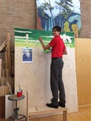 Mason Sorbara puts the first touches on the 6X8-foot Focus Festival community painting, based on Old Boy Lawren Harris' 'Snow II.'