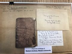 Photo of paper work attached to the Laird Journal at Western University