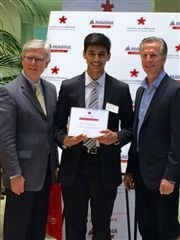 Dhruv Krishnan accepts a 2015 Give Back Award from Aurora Mayor Geoff Dawe (left) and Donald Walker, Magna CEO.