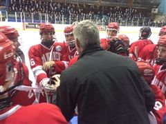 Coach Joe Foote gives the team a pep talk in the semifinals
