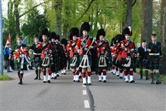 St. Andrew's Pipes & Drums Band march in VE Day Celebrations in Holland, in May 2010.