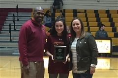 Kerrigan with Athletic Director Bryce Bevill and Coach Erin Simons