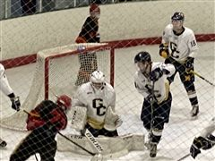 Cardinals (black) swarm the Good Counsel net in first period action.
