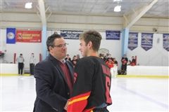 Coach of the Year Anthony DiCarlo congratulates senior captain Graham Kalan on Senior Night