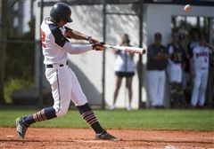 Benjamin outfielder Isaiah Thomas (32) hits a two-run homer against American Heritage in Palm Beach Gardens on March 12. Thomas and the Buccaneers took the top spot in this week's baseball rankings. (Andres Leiva / The Palm Beach Post)