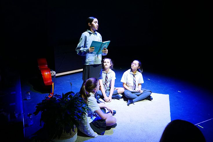 Students performing in a stage production