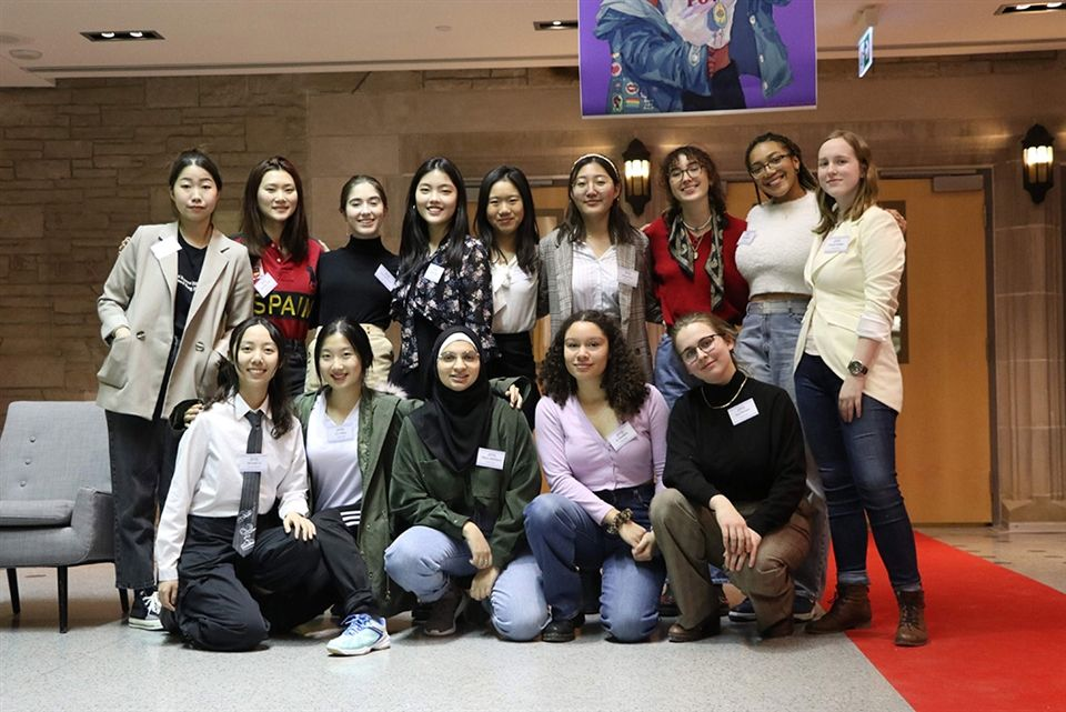 A group of students involved in the FeMILY organization pose together for a photo