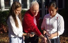 Br. Ken instructs two students in the set up for their fox hunt.