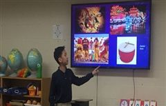Cedric Li ' 24 presents to his classmates during the Lower School Chinese New Year celebration.