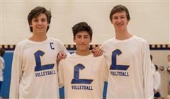 Samuel Clark '19 (right) with Drew Potter '18 (left) and Brandon Whitney '19 (middle) during the 2017 MIAA Volleyball season.