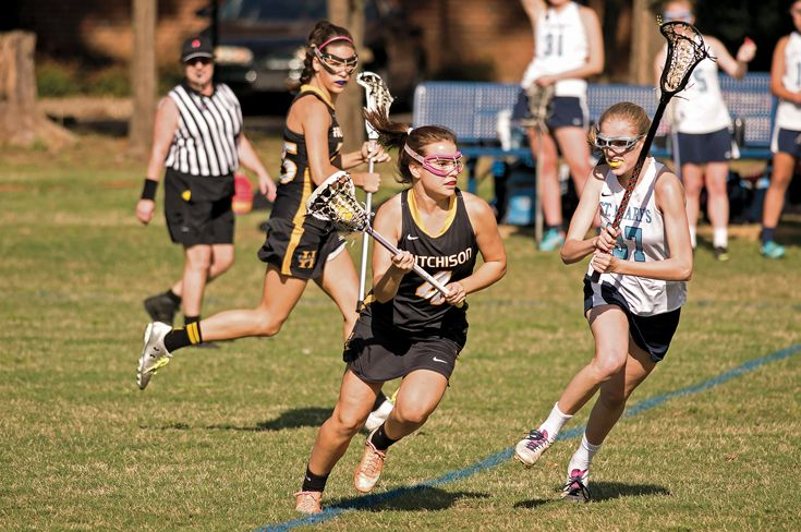 Griffin Gearhardt '17 (foreground) and Daisye Rainer '17 (background) are part of Hutchison's current championship lacrosse team.