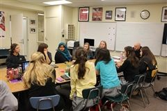 Upper school girls in Nick Simpson's debate class are engaged in the issues.