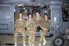 Huygen (second from left) deployed to Afghanistan from July 2012-February 2013. She's shown with her staff, an Air Force Judge Advocate and two paralegals.