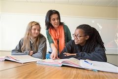 Alejandra works with upper school girls in one of her Spanish classes.