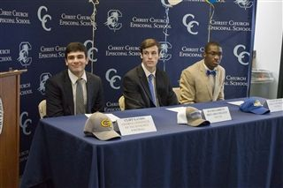 Cliff Gandis, David Garrett, and Jacobe Putman sign their letters of intent