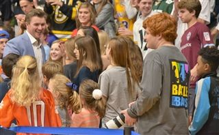 High fives at the basketball game!
