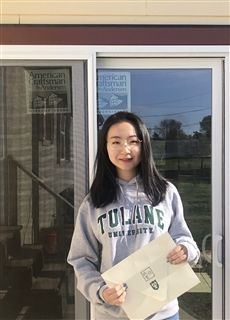 Sherry proudly displays her Tulane acceptance!