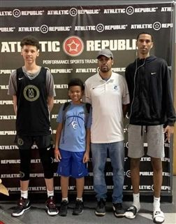 The four Butler boys on a family trip for a basketball tournament
