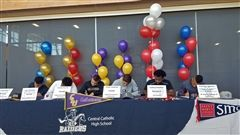 Six seniors signing their National Letters of Intent