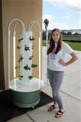 Senior Elisabeth Watkins with one of the two new grow towers.