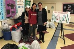 Green Team leaders S. Lu '18 and J. Yu '20 and advisor Meghan Gayton survey the textile drop-off bins.