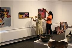 Painter Karyn Koulopoulos (left) and clay artist Arti Bhola Goulatia prepare the gallery in advance of the exhibit's opening on September 11