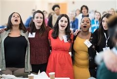 Emily Soukas '09 (center) sings the Alma Mater with classmates at Spring Reunion 2019